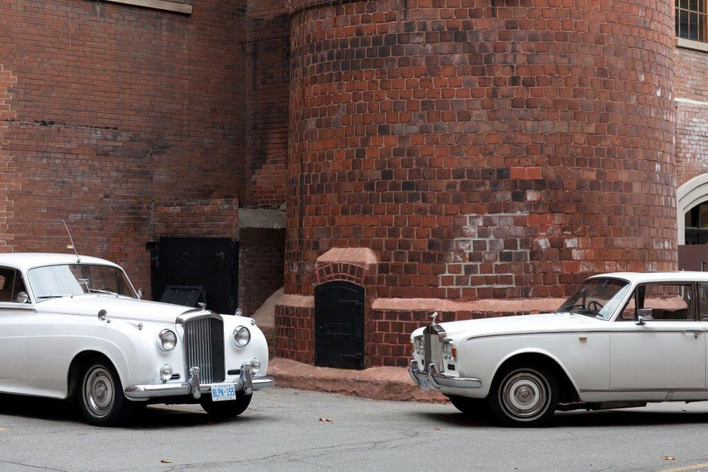 Vintage Cars in front of brick wall for media shot