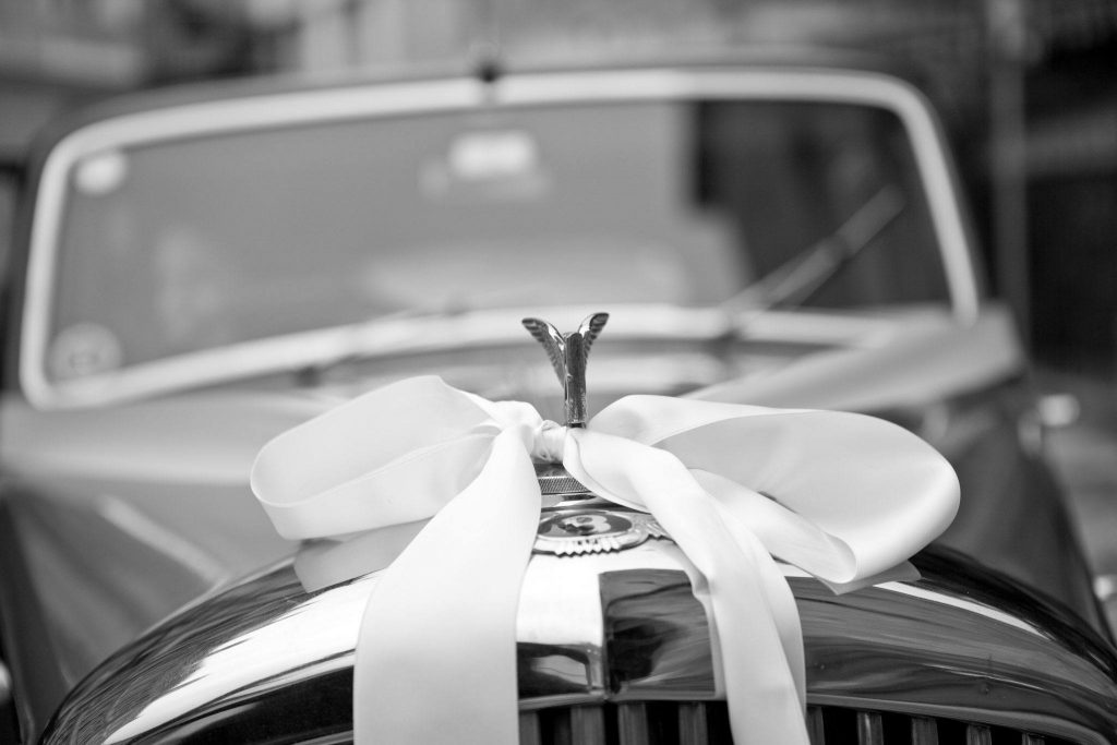 Bentley covered in ribbon for the wedding